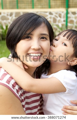 Daughter hug And Kiss Her Mother - stock photo