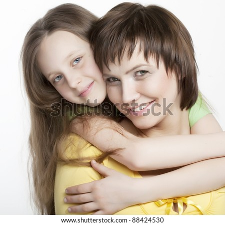 Daughter Hugging Mother - stock photo