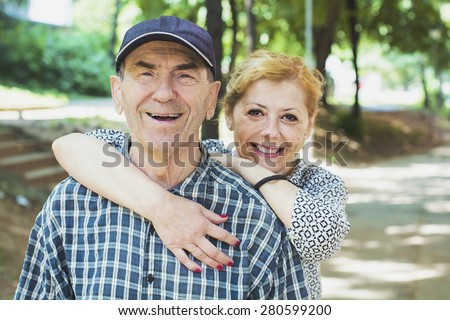 Daughter hugging old father  - stock photo