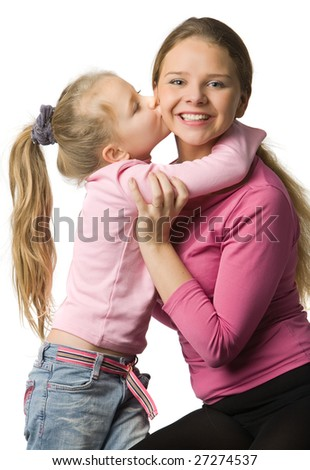 Daughter  in pink  clothes embrace a mother and kisses in a cheek, isolated on white