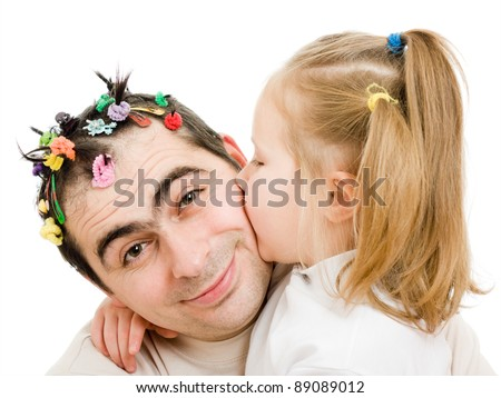 Daughter kissing her father on a white background. - stock photo