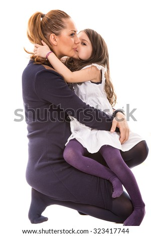 Daughter kissing her mother isolated on white background - stock photo