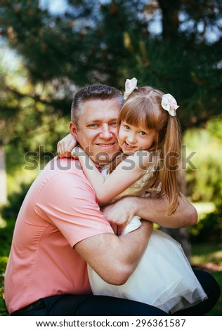 Daughter playing with her father in the park
