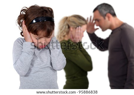Daughter stood with arguing parents - stock photo