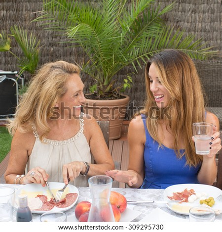 Daughter talking with her mother - stock photo