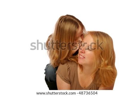 Daughter telling mom a secret - stock photo