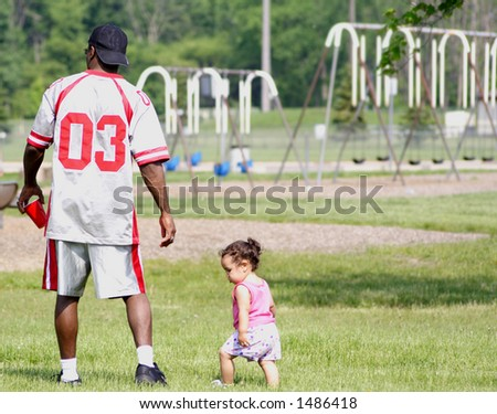 Daughter trying to be like her daddy - stock photo