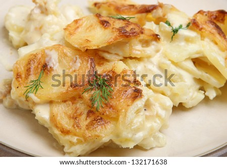 Dauphinois potatoes served on a plate. - stock photo