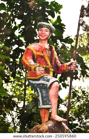 DAVAO/PHILIPPINES - FEBRUARY 05: Typical Filipino tribal farmer statue on February 5th 2015. Tribal Filipino statues are widely spread in the public and touristic areas in Davao city Philippines.