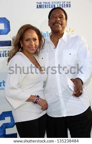 "Dave Winfield and guest at the ""42"" Los Angeles Premiere, Chinese Theater, Hollywood, CA 04-09-13"