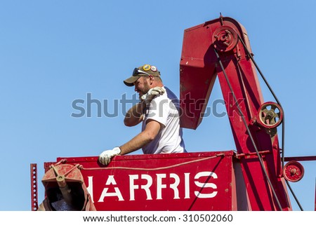 Davenport, WA. USA - Aug 22, 2015. An image of a farmer in a combine during the Davenport, Washington vintage harvest August 22, 2015. - stock photo