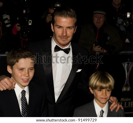 David Beckham and sons  Brooklyn and Romeo arriving for The Sun Military Awards 2011 at the Imperial war Museum, London. 19/12/2011 Picture by: Simon Burchell / Featureflash - stock photo