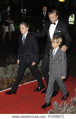 David Beckham with sons, Brooklyn and Romeo arriving for The Sun Military Awards 2011 at the Imperial war Museum, London. 19/12/2011 Picture by: Steve Vas / Featureflash - stock photo