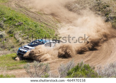 David Higgins and Craig Drew driving their Subaru Rally car around a tight dirty corner at Oregon Trail Rally, a National Rally America Championship location, on April 23rd, 2016 in Dufur, OR.