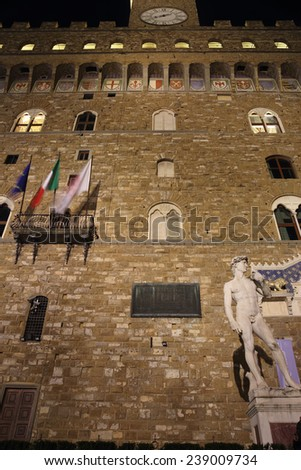 David statue at night in Piazza della Signoria square. The masterpiece by sculptor Michelangelo at the entrance of palazzo Vecchio, Florence , Italy - stock photo