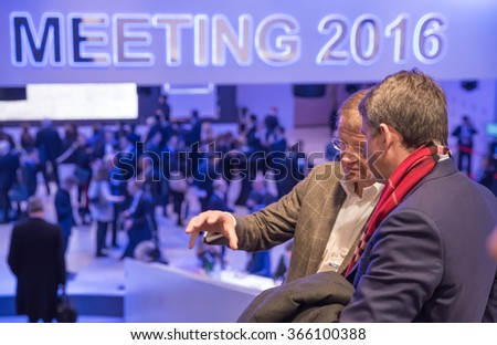 DAVOS, SWITZERLAND - Jan 21, 2016: Working moments. Participants of the World Economic Forum in Davos (Switzerland) - stock photo