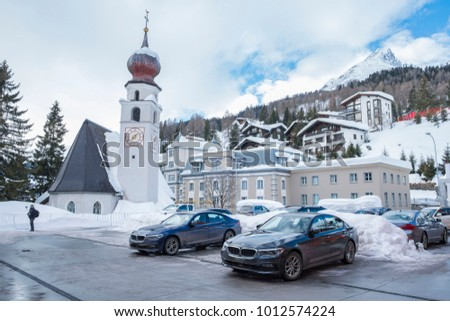 "DAVOS, SWITZERLAND- JANUARY 26, 2018: World economic forum annual meeting. The photo shows the parking spot with government limousines and the Steigenberger grandhotel ""Belvedere"" in the background."