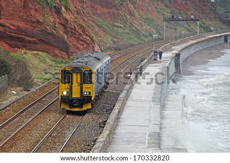 DAWLISH, DEVON, ENGLAND - JAN 8, 2014: A First Great Western Class 150/2 Sprinter Train between Dawlish and Dawlish Warren.  Extensive storm damage closed this section of line for repair in Feb 2014.