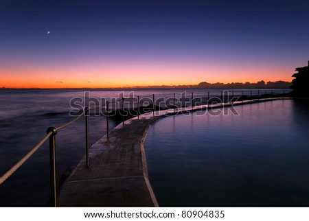 Dawn at a tidal pool in Bronte, a famour beach in eastern Sydney, Australia - stock photo