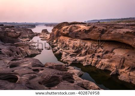 dawn at canyon of Sam Pan Bok in Ubonrachatani northeast of thailand - stock photo
