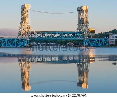 Dawn at Portage Lake (Houghton-Hancock) Lift Bridge from Hancock from Bridgeview Park - stock photo