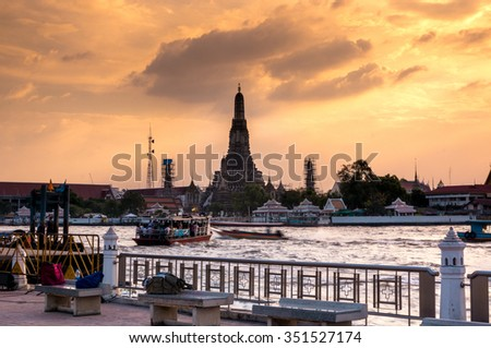 Dawn at Wat Arun Ratchawararam Ratchawaramahawihan or Wat Arun Temple (The temple of dawn) view, Bangkok, Thailand - stock photo