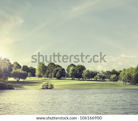 Dawn by the lake - stock photo