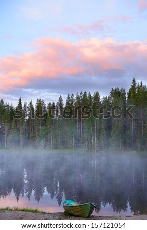 Dawn. Fog over the lake. Northern Finland, Lapland