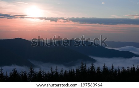 Dawn in the mountains.Morning fog in the Ukrainian Carpathians