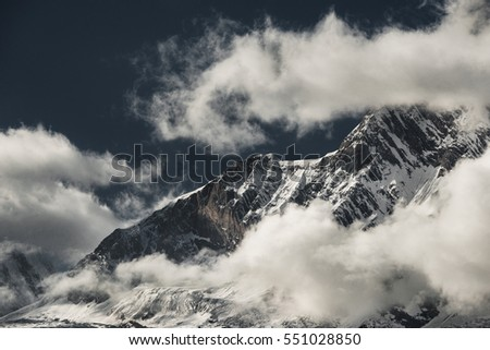 Dawn in the mountains, when a lot of clouds, glaciers, blue mountain ranges and the first rays of the sun. Nepal, Manaslu