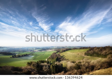 Dawn landscape in springtime with clouds in England - stock photo