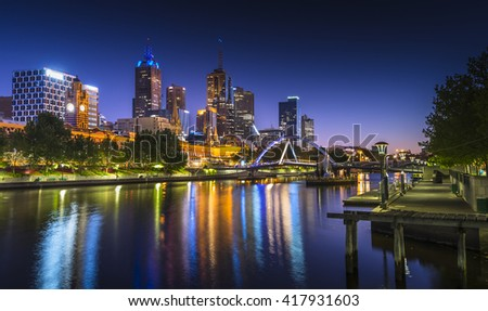 Dawn light city skyline reflections Melbourne river view