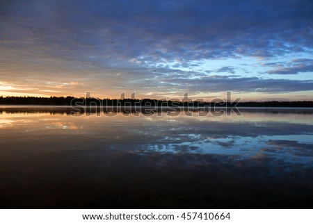 Dawn on the lake - stock photo