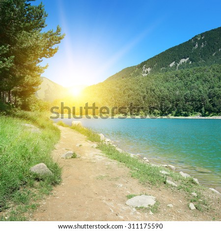 Dawn on the shores of picturesque Lake - stock photo