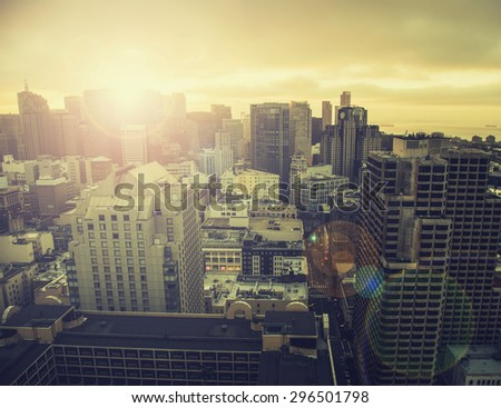 Dawn over San Francisco with added Instagram filter and lens flare - stock photo