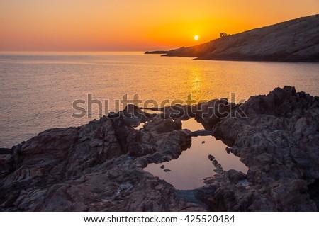 Dawn over the sea bay on the island. - stock photo