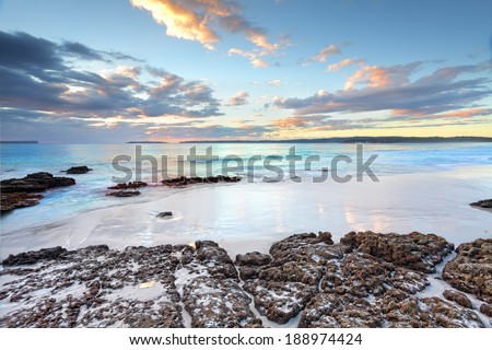 Dawn skies and ocean beach Jervis Bay NSW Australia - stock photo