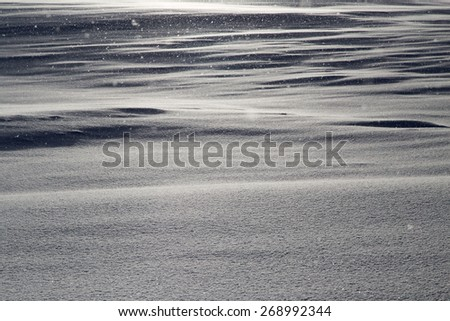 dawn sun in the snowy mountains - stock photo
