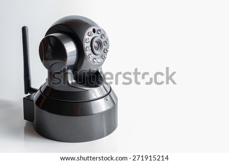 Day and night color surveillance video camera isolated on white background - stock photo