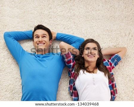 Day dreaming on carpet - stock photo