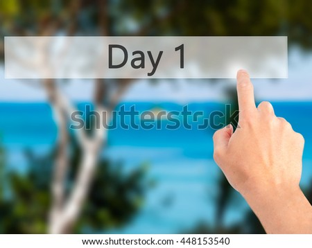 Day 1 - Hand pressing a button on blurred background concept . Business, technology, internet concept. Stock Photo