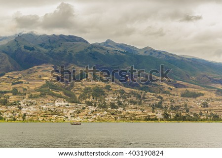 Day landscape scene photo of san pablo lake and mountain at background in Imbabura district in Ecuador, South America - stock photo