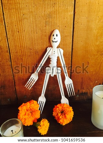 Day of the Dead handmade skeleton with marigolds and candles