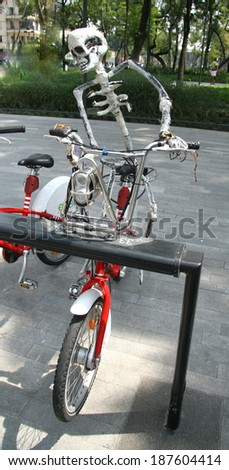 Day of the dead skeleton on a bike - stock photo