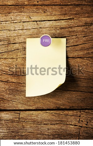 Day of week Sticky note with pin over wooden background - stock photo