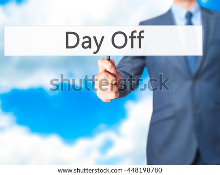 Day Off - Businessman hand holding sign. Business, technology, internet concept. Stock Photo
