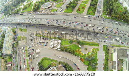 Day traffic on street and overpass bridge. View from unmanned quadrocopter. - stock photo