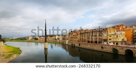 Day view of Ebre river in Tortosa. Monument to  Battle of the Ebro at river - stock photo