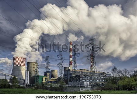 Day view of power plant, smoke from the chimney - stock photo