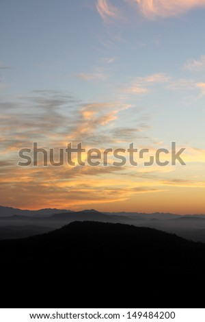 Daybreak - Dawn over the foothills of the Sierra Madre Occidental range near Mazatlan, Mexico - stock photo
